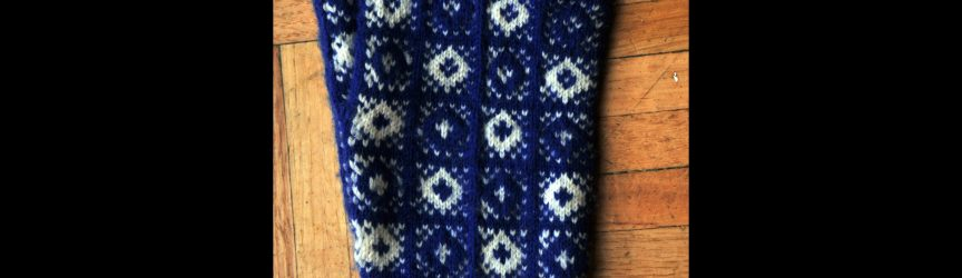 Blue and White Glove with no rib or cuff in 'Drum' Pattern. Designer/Knitter: Michelle Poulin-Alfeld, Utah. Yarn: Knit Picks Capretta, 80% merino wool, 10% nylon, 19% cashmere, 230 yards/50 grams, 11 sts/inch on 2.0 mm/US Size 0 needles. (Photo: Michelle Poulin-Alfeld)