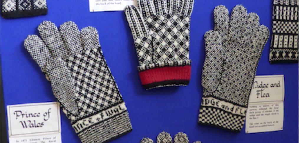 These gloves were knitted by May McCormick of Sanquhar and are shown on display in the A' the Airts Centre in Sanquhar at a study day in November 2014. (Photo: Angharad Thomas, with permission from May McCormick).